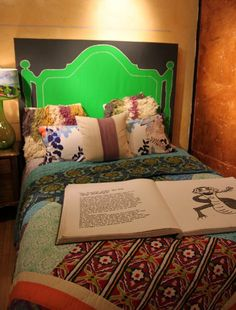 Painted canvas headboard and eclectic linens at Anthropologie.