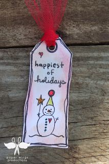 The Aviary- paper wings productions holiday tags hand stamped