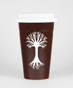 TREE Travel Mug - BROWN - Double Wall Ceramic Stoneware. Nature lovers, protect the environment by using an insulated ceramic TREE travel mug, instead of those wasteful paper cups! Microwave-safe and dishwasher-safe. We carved all the way through the shiny glaze of this double walled reusable ceramic travel mug so that the bold natural stoneware can be seen. Includes white silicone lid. Other colors may be available. Food-safe! Glaze you can feel good about: meets CA's Prop 65 limits for...