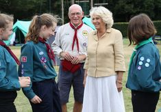 Camilla, Duchess of Cornwall meets Scouts as she visits the Poppy Pod Village at the Tile Barn Outdoor Centre on July 26, 2016 in Brokenhurst, England. The Village stands on the site of a former First Word War Hospital and provides accomodation for service personnel and their families. - The Duchess of Cornwall Visits Commonwealth War Graves & Opens Poppy Pod Village