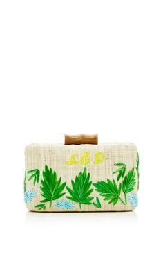 This Kayu clutch features a leaf embroidery, a bamboo toggle closure and a gold chain with a customizable monogram embroidery.