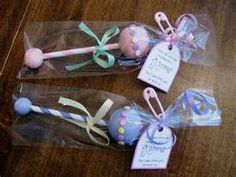 baby shower cake pops so cute looks like lil rattles! So freaking adorable I like those for party favors