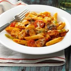 """Italian Chicken and Penne Recipe -This easy stir-fry combines the pasta with green pepper, mushrooms and tomatoes in an Italian-style sauce. """"I made up this recipe one evening, and it was a big hit with my family,"""" says Janeen Longfellow of Wolcottville, Indiana."""