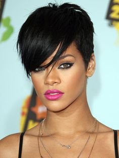 Thinking of channeling RiRi this halloween...would want to go with this hairstyle possibly...