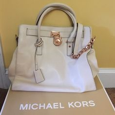 SALE Micheal Kors Large Hamilton  Cream colored authentic leather bag with rose gold lock and chain handle. Clean, no stains, excellent condition, with satin bag still available. Some scratches and tarnish on hardware behind the lock as shown in pic. Michael Kors Bags