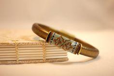 Peyote beaded bead on a Regaliz leather bracelet, seafoam, aqua, bronze, blue…