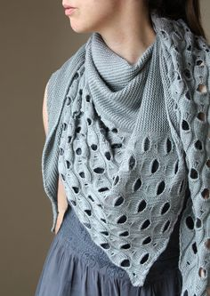"""From designer Melanie Berg: """"When I first started thinking about this design and what I wanted, I stumbled over a photograph of a whale shark and its fascinating patterning. I looked at many other pictures, but somehow kept coming back to this one.  This shawl is my take on translating this graphic pattern into knitwear—its wavy lines, its dots and the fluid overall impression.  Canopy Fingering turned out to be the perfect yarn choice - its amazing stitch definition really lets the pattern…"""