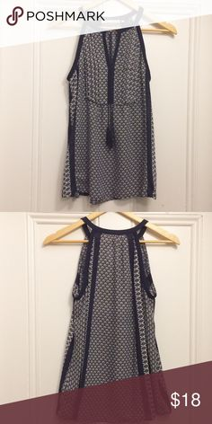 Violet & Claire, halter top style blouse, size S Halter top style blouse, blue and white patterns with small tassels in the front. Size S, 100% polyester, NWOT Violet & Claire Tops Blouses