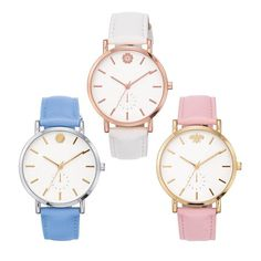 """Make a charming statement with the strap watch that comes in three darling hues.FEATURES• 34mm diam. case• 9.25"""" L strap• Round face• Faux chronograph at the bottom of the dialMATERIALS• White bronze silvertone metal (blue watch with sun design)• Goldtone metal (pink watch with bee design)• Rose goldtone metal (white watch with flower design)• Leather-like strapImported"""