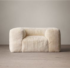Fulham Shearling Chair - and the big cloud's little sibling. Both have massive fluffy ottomans