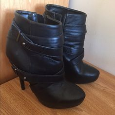 Black Platform Booties Gorgeous black high heeled booties with a little platform, perfect for any occasion! They have only been worn one time, and are in pristine condition! Please note- item will not be shipped until Saturday, March 18, as I am away. ****ABSOLUTELY NO TRADES Shoes Ankle Boots & Booties