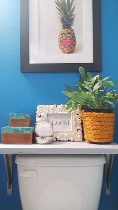 We love the eclectic look of this bathroom styled by Whitney Jones of Whitney J Designs. Look at the over-the-toilet shelf. It's made of concrete!-- a DIY project by Whitney. See the full tutorial for the shelf on The Home Depot Blog.