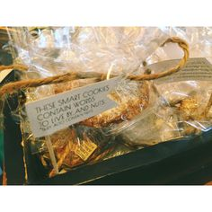 """Give your guests a favor to remember with these """"smart cookies"""" I saw at Evangeline Lane Photography's booth at the Lovesick Expo. They're like a more homemade, rustic twist on fortune cookies with sweet quotes cooked in them."""