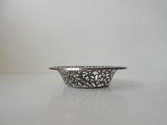 Small piercet art nouveau vessel/bowl from WMF - 925s: http://retro-design.dk/butik/bon-bon-skaalkurv-i-sterling-soelv-wmf-ca-1900/