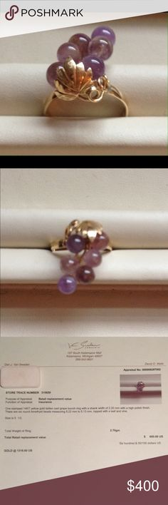 A Bunch of Amethyst Grapes on a 14K ring The stamped 14k yellow gold ring has a shank width of 2.2 mm. The bunch has 6 round 5 mm natural Amethyst beads of different shades topped with a leaf and vine. So unique. Appraised for $600 on 6-26-16. Appraisal included with sale. Jewelry Rings
