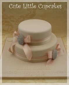 Diamond Wedding Anniversary cake in champagne fondant, trimmed with ribbon & decorated with keepsake diamond brooches x