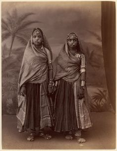 Two Hindu Women in Elaborate Jewelry, Before Studio Backdrop with Palm Trees. 1860s