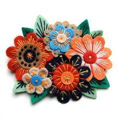 Vintage Bouquet felt flower brooch with freeform hand embroidery. £18.00, via Etsy.