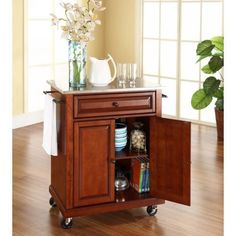 Constructed of solid hardwood and wood veneers, this portable kitchen cart is designed for longevity. The beautiful raised panel doors and drawer front provide the ultimate in style to dress up your kitchen. The deep drawer is great for anything from Rolling Kitchen Island, Kitchen Island Cart, Kitchen Islands, Kitchen Carts, Kitchen Ideas, Island 2, Kitchen Decor, Kitchen Tips, Diy Kitchen