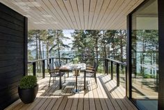 modern-wooden-vacation-house-built-on-rocks-4-roof-overhang.jpg