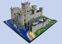 Enormous LEGO castle dominates the shoreline Medieval Armor, Medieval Castle, Medieval Fantasy, Minecraft Castle, Minecraft Medieval, Minecraft Stuff, Minecraft Ideas, Lego Stuff, Lego Roman