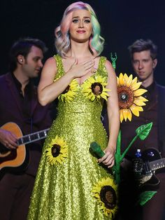 Star Tracks: Monday, April 20, 2015 | FLOWER CHILD | Wearing the full color spectrum between her outfit and her hair, Katy Perry performs in China at the Guangzhou International Sports Arena on Saturday as part of her world tour.