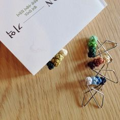 https://www.facebook.com/elknot  '#ring_clip' made by 'ring knot', a kind of Korean traditional knots. People usually put a ring to memorizes or commemorate something which people spent a lot of time and concern. Like the usage of a ring, '#ring_clip' was designed for book-clip since reading require people to spent a number of time and interest, and thus it will help people to trace their memories by putting the '#ring_clip'.