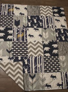 Woodland , Deer , Moose , Arrow , Forest , Grey Chevron , is the theme to this addorable baby/toddler quilt . I made this quilt using my very own large