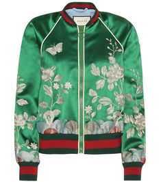 Gucci - Embroidered silk bomber jacket - Gucci goes for an almost oriental feel with this statement design. Updating the silhouette of the season in signature house style, the emerald green bomber jacket features ornate metallic embroidery all over. Ribbed trims in the brand's green and red striping keep the style sporty and recognizable. We like ours as the contemporary finishing touch to ladylike ensembles. seen @ www.mytheresa.com