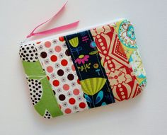 Padded Zipper Pouch Quilted Patchwork Designer Fabrics. $9.00, via Etsy.