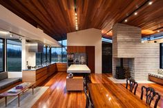 Kitchen, Dining Space, Fireplace, Wairau Valley House in Rapaura, New Zealand by Parsonson Architects
