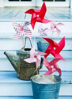 Patriotic pinwheels. More red, white and blue decorating:  http://www.midwestliving.com/homes/seasonal-decorating/easy-red-white-and-blue-decorating-ideas/page/9/0