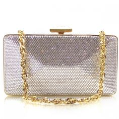 This is a guaranteed authentic Judith Leiber evening bag.   This is made out of embossed silver leather with gold tone hardware.