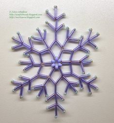 Free detailed tutorial with step by step photos on how to make a snowflake out of seed beads, bugle beads and wire. Great for beginners! Beaded Christmas Ornaments, Snowflake Ornaments, Christmas Snowflakes, Christmas Jewelry, Beaded Snowflake, Snowflake Pattern, Wire Ornaments, Seed Bead Tutorials, Beading Tutorials