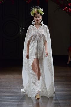Naeem Khan Fall 2016 embroidered lace mini wedding dress with floor-length cape | https://www.theknot.com/content/naeem-khan-wedding-dresses-bridal-fashion-week-fall-2016