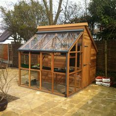 The Gabriel Ash Classic Grow and Store is part greenhouse, part storage shed, and entirely constructed from western red cedar, which not only looks great, but contains natural preservatives allowing greater longevity and resistance to rot. Greenhouse Shed, Small Greenhouse, Greenhouse Wedding, Indoor Greenhouse, Greenhouse Gardening, Wooden Greenhouses, Tempered Glass Door, Shed Kits, Potting Sheds