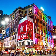 Macy's Flagship Store at Herald Square in midtown Manhattan. Built in Macy's Herald Square was the first building in the world to have the modern day escalator. The wooden escalators are still in use today! New York City Shopping, Macy's Herald Square, Manhattan, Places Ive Been, Times Square, Hotels, World, Store, Building