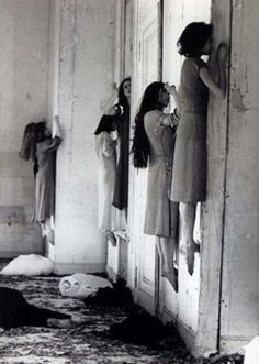 """Whisper, whisper."" Another pinner, Donnalee Leinbach, I think correctly deciphered this creepy photograph! She believes they are standing on the windowsill with their left foot. Me too. But why???"
