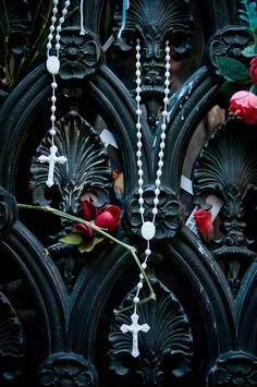 Flowers and rosaries hang from Evita's tomb (Duarte) in La Recoleta cemetery Buenos Aires, Argentina.