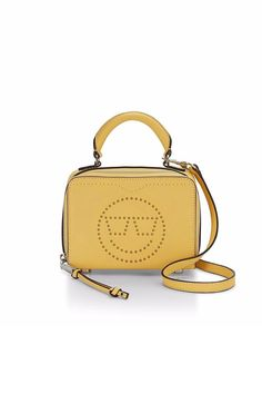 """Emoji with those blushed cheeks and closed eyes. That sums up how we feel about our perforated box bags. They zip on three sides, so you can stuff it full, and feature a top handle for lunchbox vibes (in the best way) and a detachable strap for those hands-free moments. Leather exterior, trim and handles Silver hardware Top zip closure Cotton twill lining 1 Interior slip pocket    7""""W x 5.25""""H x 2.5""""D 23"""" Removable and adjustable strap 2.5"""" Handle drop   Happiness Perf Crossbody by Rebecca…"""