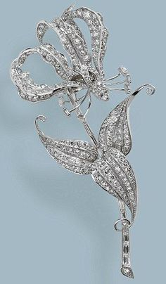 The Queen's priceless Flame Lily brooch. It is thought to feature around 300 diamonds on a platinum base and was 21st birthday present to Princess Elizabeth from all 42,000 school children in southern Rhodesia (now Zimbabwe). Each child had donated  three pence to pay for the brooch which was created in the shape of the flame lily, a national flower of the country. The brooch was made in Africa in 1947.