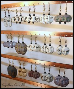 EARRING DISPLAY - buy flat metal bars at hardware store & drill holes to display earrings. Screw metal bars onto wooden braces. by Cynthia Gordillo, via Flickr