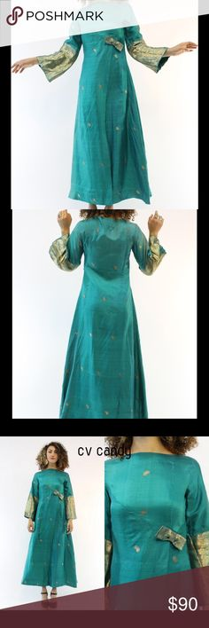 """Vintage from 1970's silk dress The ultimate bohemian gown! Done in a metallic turquoise silk material. Accents of gold lurex stitching decorate the bell sleeves  and make up the small paisley pattern throughout the dress. Back a-line zipper  Wrap like skirt. Lined in a green lining. M A T E R I A L : Silk C O N D I T I O N : Very Good Vintage: Fading on both shoulders, the right sleeve has fading as well B U S T: 34"""" W A I S T : 30"""" H I P S : 44"""" L E N G T H : 52.5"""" S H O U L D E R S: 15"""" S…"""