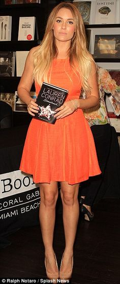 Excited to be there: The reality television personality looked happy to be hawking books in Miami  Photo By Ralph Notaro