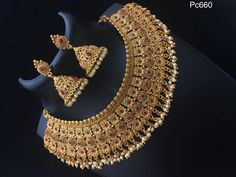 Sep 2017 - Beautiful necklace with flower bunch design. Necklace studded with pink color stones and guttapusala hanging. Indian Bridal Jewelry Sets, Bridal Jewelry Vintage, Gold Bangles Design, Gold Jewellery Design, Gold Temple Jewellery, Gold Jewelry, Antique Jewellery Designs, Jewelry Design Earrings, Pink Color