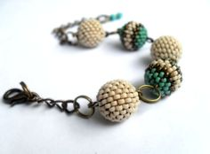 Bracelet composed by five handmade beaded beads.