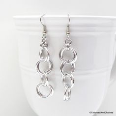 Every woman needs a simple pair of chainmaille earrings in goes-with-everything silver aluminum. The chain is comprised of large aluminum jump rings that are möbiused and connected together. They have                                                                                                                                                                                 More