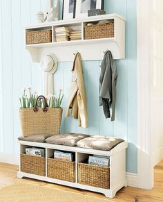 Utilize a small entry or hallway with storage cubbies for shoes and hats, hooks for coats & bags, and a basket for umbrellas - the perfectly organised entryway!