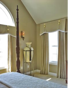 Gorgeous window treatments in this bedroom. I can't think how people can sleep with tons of light flooding the room! (But the fanlight over the bed isn't covered...)