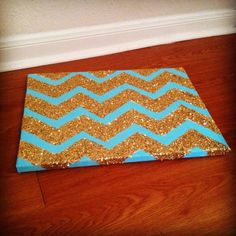 you can do this with a shoebox lid. paint the entire thing one color. after it dries, make the chevron pattern with painters tape. make a mixture of mod podge and glitter to coat the spaces not covered with painters tape.-- SO smart for the quote wall, shoe box lids- we could just mod podge on them